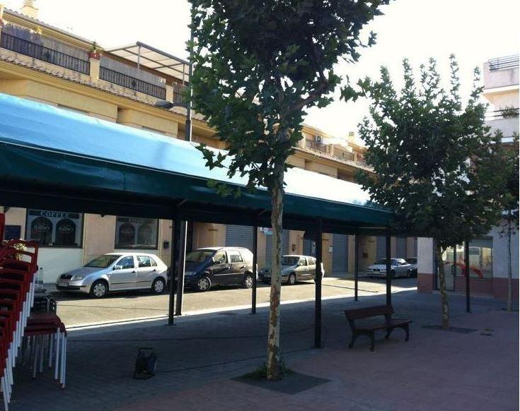 Cerramientos de terrazas de bares en granada toldos aire for Donde queda terrazas